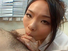 Fujiko Komine gets onto her knees while sucking on a pale shaved cock