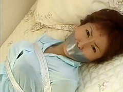 japanese girl tape gagged in skirt and blouse